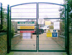 Gates at the corner of Wharf Lane and the service road